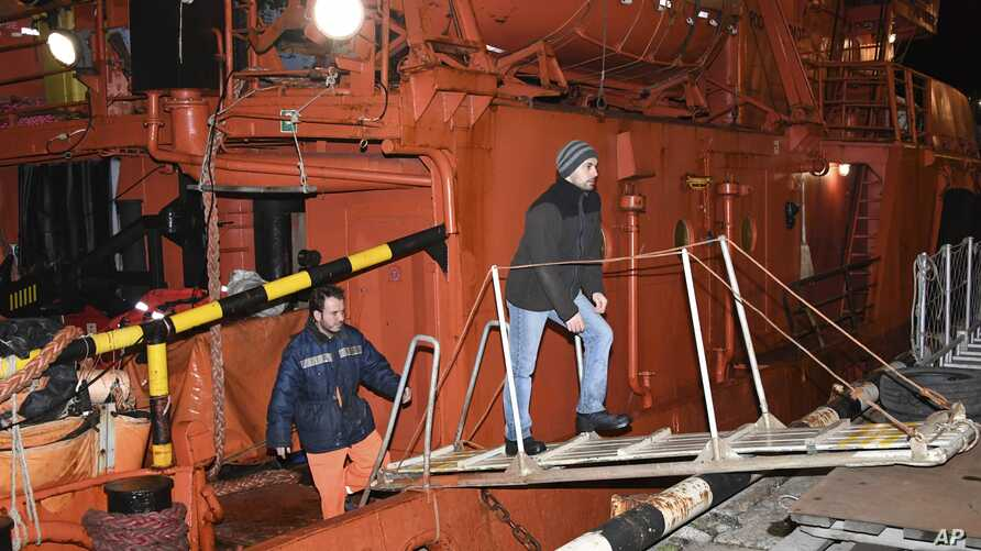 Survivors of a ship fire on Tanzania's vessels, the Candy and the Maestro, in the Kerch Strait arrive at the Kerch sea port, Crimea, Jan. 22, 2019.