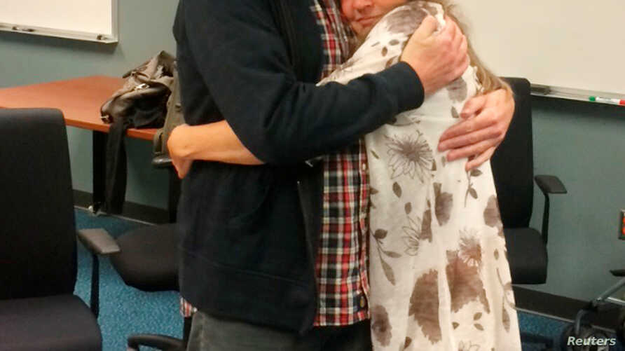 Kevin Garratt, a Canadian held in China for two years on suspicion of spying, hugs wife Julia Garratt after being deported by Chinese authorities, in Vancouver, British Columbia, Canada, Sept. 15, 2016. The family took and released the photo via Reut