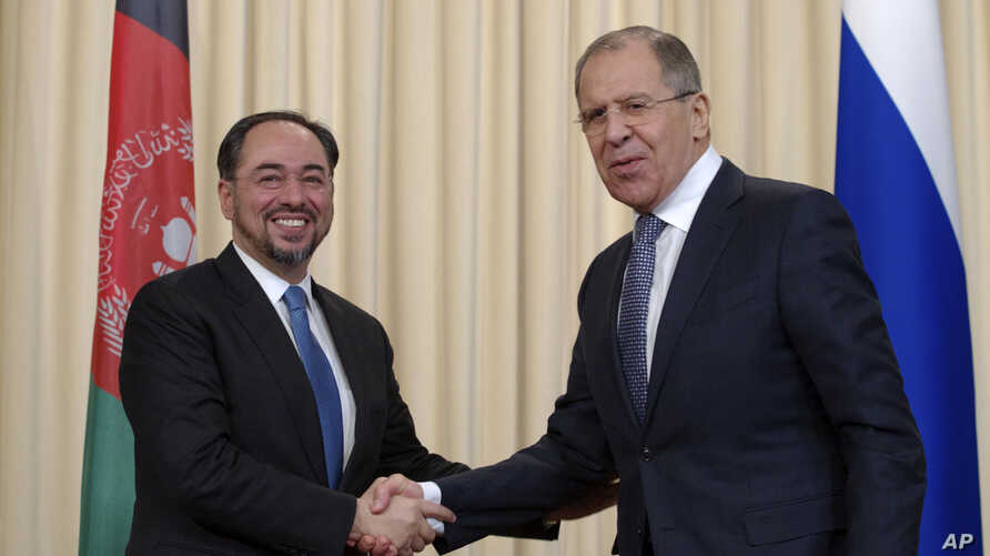 Russian Foreign Minister Sergey Lavrov, right, and his Afghan counterpart Salahuddin Rabbani shake hands after their meeting in Moscow, Russia, on Tuesday, Feb. 7, 2017.