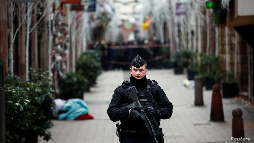 A French gendarme secures a street at the scene of a police operation the day after a shooting in Strasbourg, France, Dec. 12, 2018.