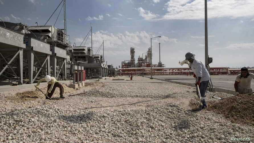 Iranian laborers work at a unit of South Pars gas field in Asalouyeh Seaport, north of Persian Gulf, Iran, Nov. 19, 2015. China's state-owned CNPC energy company now owns 80 percent of the project's share after Total dropped out because of U.S. sanct
