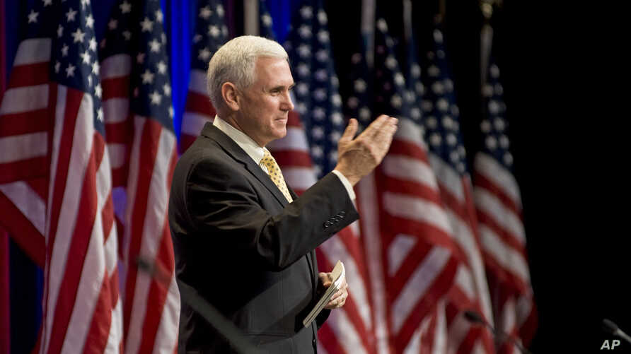 In this Feb. 19, 2010 file photo, Rep. Mike Pence, R-Ind., gestures while addressing the Conservative Political Action Conference (CPAC) in Washington.