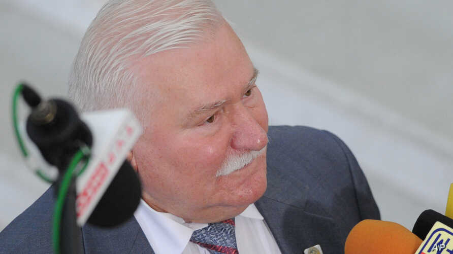 FILE - Former Polish President Lech Walesa speaks to journalists, in Warsaw, Poland,  Aug. 6, 2015.
