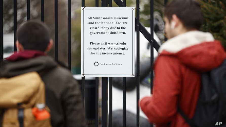 A closed sign is posted on the gate of Smithsonian's National Zoo, Wednesday, Jan. 2, 2019, in Washington. Smithsonian's National Zoo is closed due to the partial government shutdown.