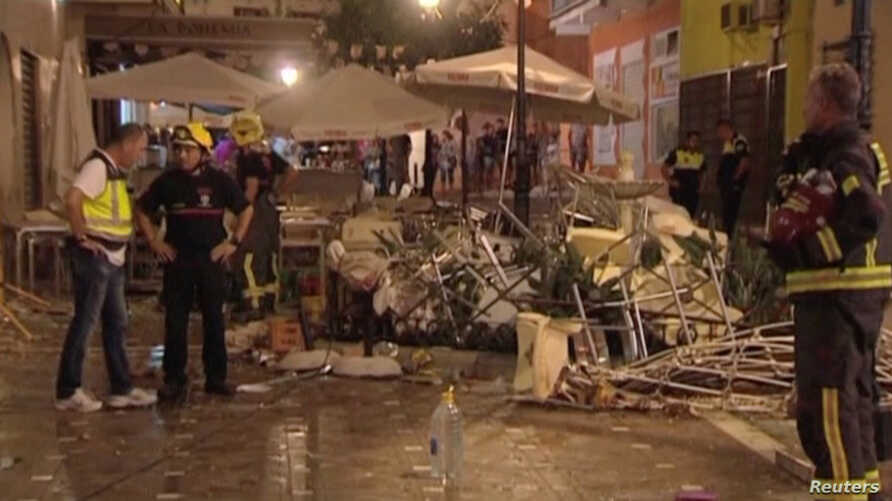 In this still image taken from video, police and rescue services are pictured at the scene after a gas cylinder exploded in a cafe in Velez-Malaga, Spain, Oct. 1, 2016.