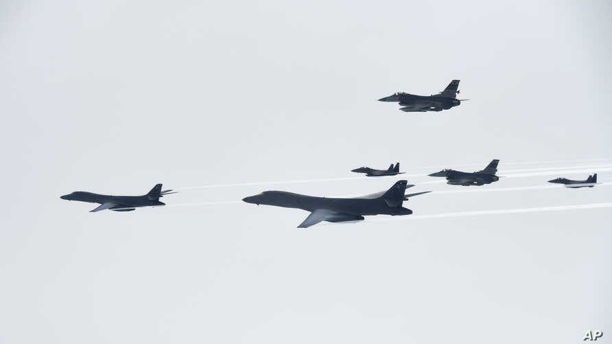 U.S. Air Force B-1B Lancer bombers, left and second from left, fly with South Korean and U.S. fighter jets over the Korean Peninsula, South Korea, July 8, 2017, in this photo provided by South Korea Defense Ministry.