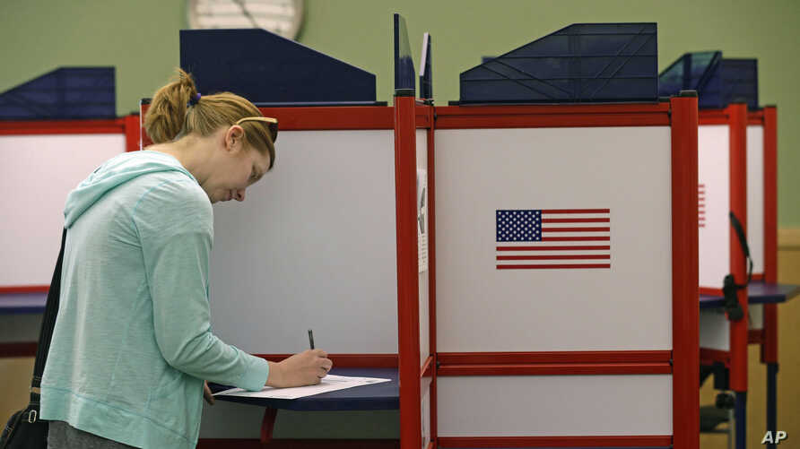 A woman casts her vote during primary voting in Durham, N.C., May 8, 2018.