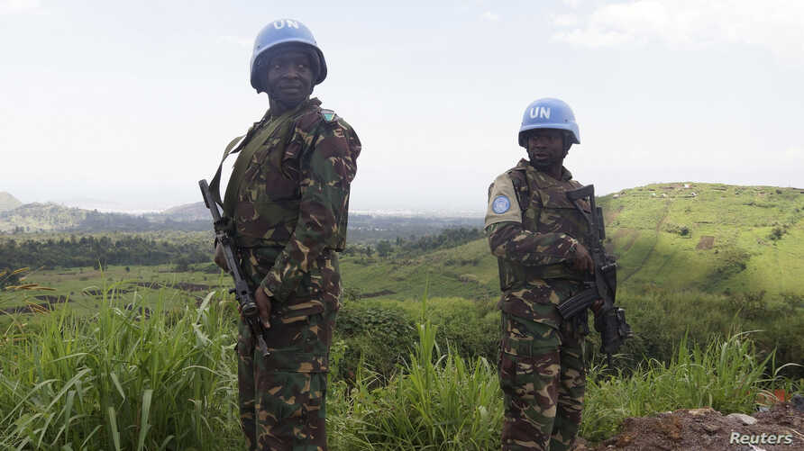 FILE - UN peacekeepers from Tanzania hold their weapons as they patrol outside Goma.