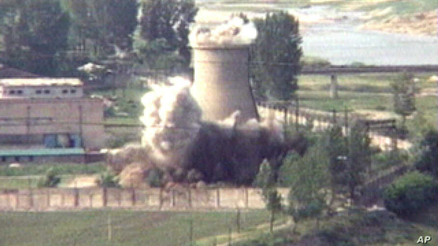 ** FILE **  In this June 27, 2008, file image from television,  the demolition of the 60-foot-tall cooling tower at its main reactor complex in Yongbyon North Korea.   North Korea said Tuesday, Aug. 26,2008,  it has stopped disabling its nuclear reac