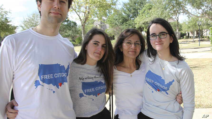 "Wearing T-shirts with the message ""Free the Citgo 6,"" the Vadell family poses for a photo in Katy, Texas, Feb. 15, 2019."