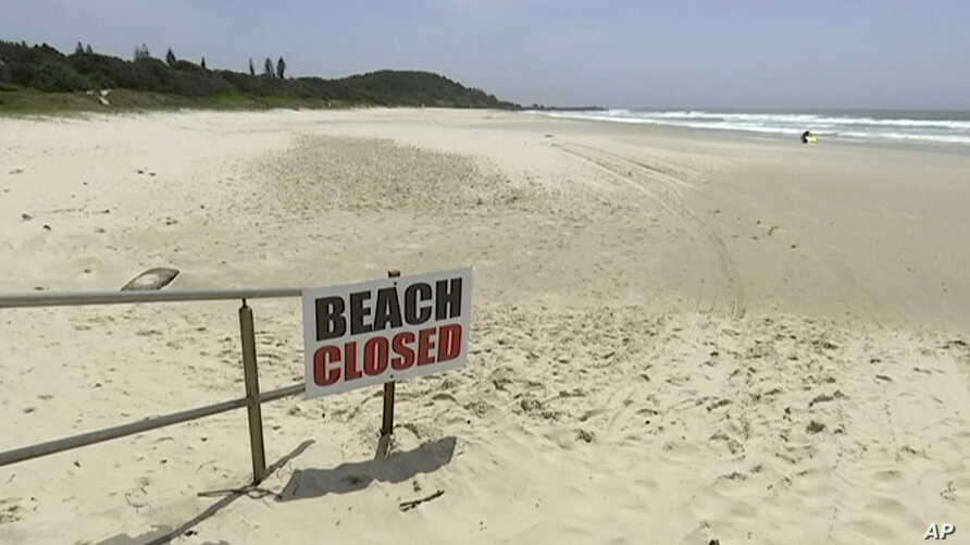 This Nov. 7, 2018, image made from video shows the beach where a shark attack occurred in Ballina, Australia.