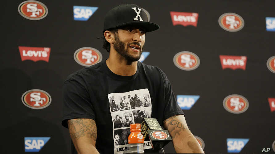 San Francisco 49ers quarterback Colin Kaepernick answers questions at a news conference after an NFL preseason football game against the Green Bay Packers Friday, Aug. 26, 2016.