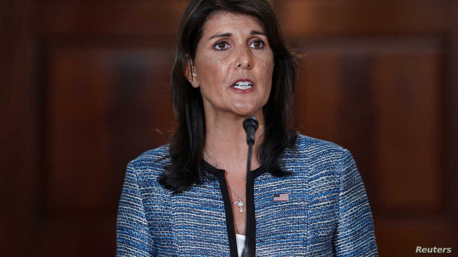 U.S. Ambassador to the United Nations Nikki Haley delivers remarks to the press together with U.S. Secretary of State Mike Pompeo (not pictured), announcing the U.S.'s withdrawal from the U.N's Human Rights Council at the Department of State in Washi...