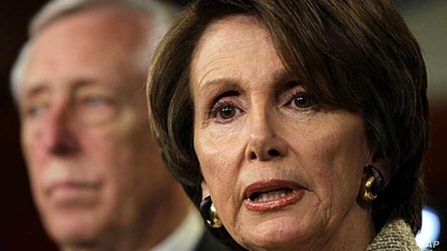 U.S. House Minority Leader Rep. Nancy Pelosi (R) speaks as House Minority Whip Steny Hoyer (L) listens during a news conference on Capitol Hill in Washington, DC, December 16, 2011.