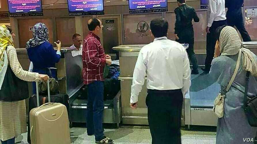 """Display screens at Iran's Tabriz International Airport display an anti-government message by a group calling itself Tapandegan on June 6, 2018, in this photo tweeted by state-run newspaper """"Iran."""""""