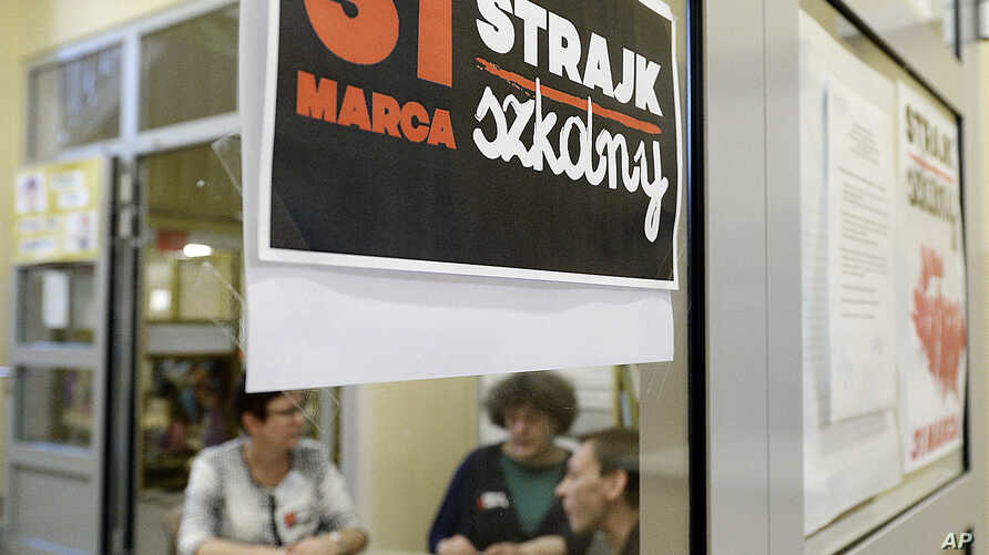 "A poster at  the door in a school  reads:  ""School Strike March 31"" in Warsaw, Poland, on March 31, 2017."