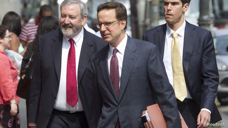 Attorneys Jonathan Blackman (L) and Carmine Boccuzzi (C), lead lawyers representing Argentina in its ongoing debt talks, arrive at federal court for a hearing in New York, August 1, 2014.