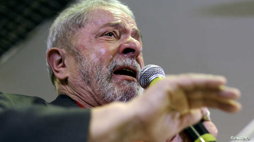 Brazil's former President Luiz Inacio Lula da Silva cries as he talks to the journalists during a news conference in Sao Paulo, Brazil, Sept. 15, 2016.