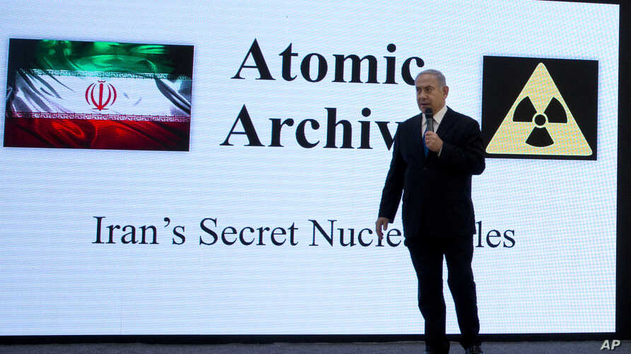 Israeli Prime Minister Benjamin Netanyahu presents material on Iranian nuclear weapons development during a press conference in Tel Aviv, April 30 2018.