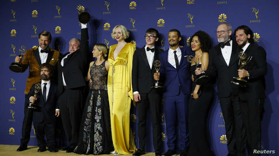 "The cast poses backstage with the Outstanding Drama Series award for ""Game of Thrones"" at 70th Primetime Emmy Awards in Los Angeles, Sept. 17, 2018."