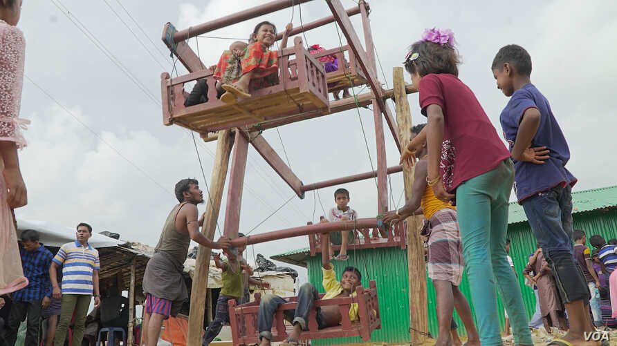 Children enjoy a manual ferris wheel ride during the Eid Al-Adha religious celebration at the Kutipalong refugee camp in Cox's Bazar this week.