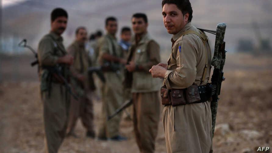 FILE - Armed members of the Kurdistan Democratic Party (KDP), take part in routine military exercise in Koya, 100 km east of Irbil, the capital of the autonomous Kurdish region of northern Iraq, Oct. 22, 2017.