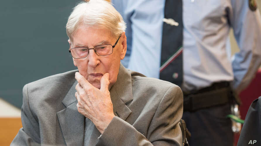 FILE - Former SS sergeant Reinhold Hanning, who served as a guard at Auschwitz, is seen in a courtroom in Detmold, Germany, June 17, 2016. Hanning died Tuesday, his attorney said without providing further details.