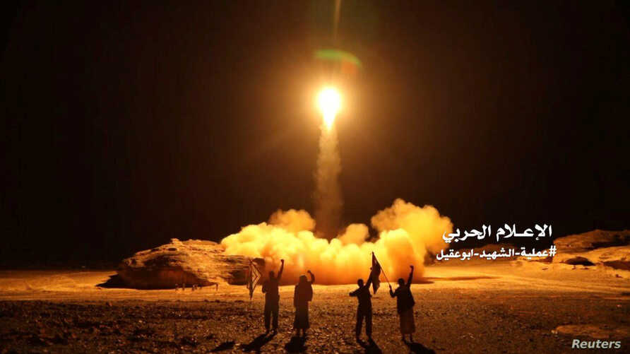 A photo distributed by the Houthi Military Media Unit shows the launch by Houthi forces of a ballistic missile aimed at Saudi Arabia March 25, 2018.