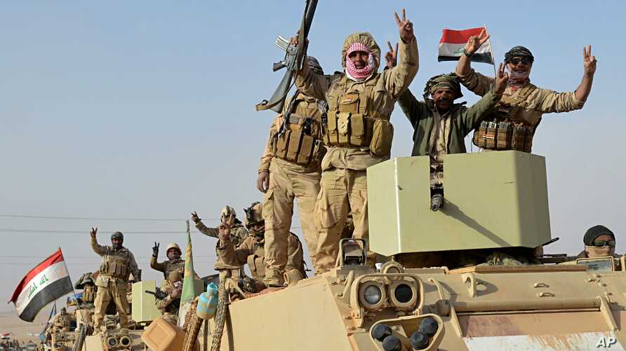 Iraqi security forces deploy in Rawah, northwest of Baghdad, Iraq, Nov. 17, 2017. Iraqi forces backed by the U.S.-led coalition retook the last town in the country that was held by the Islamic State group.