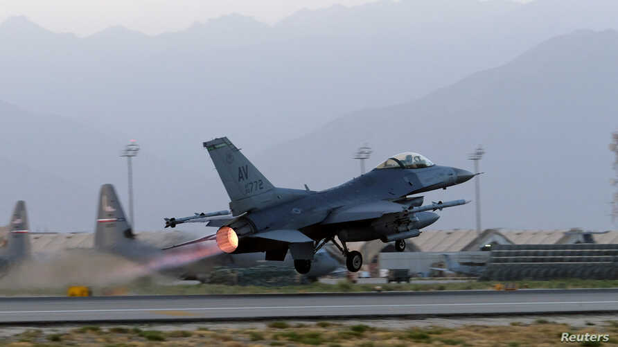 FILE - A U.S. Air Force F-16 Fighting Falcon aircraft takes off for a nighttime mission at Bagram Airfield, Afghanistan, Aug. 22, 2017.