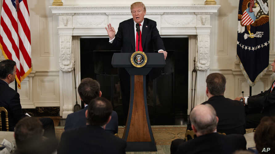 President Donald Trump speaks during a meeting with the members of the National Governors Association in the State Dining Room of the White House, Feb. 26, 2018, in Washington.
