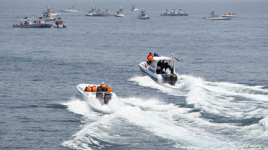 FILE - Iranian speed boats take part in naval war games in the Persian Gulf and the Strait of Hormuz, off southern Iran, April 22, 2010.