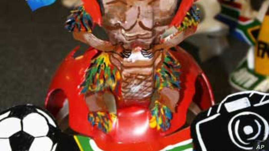 A Makarapa designed by Alfred Baloyi bears the likeness of a Zulu warrior waving South Africa flags