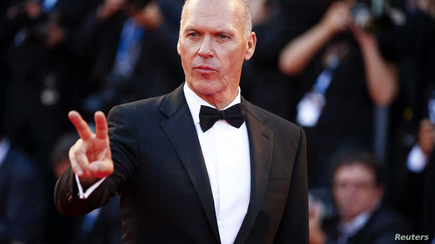 """FILE - Actor Michael Keaton, who received a Golden Globe nomination for best actor in a comedy or musical for his role in """"Birdman,"""" appears at the 71st Venice Film Festival, Aug. 27, 2014."""
