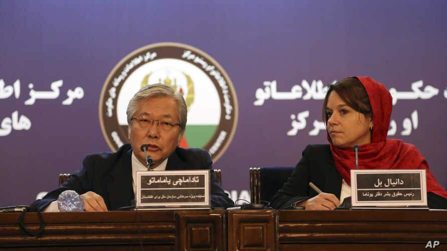 Tadamichi Yamamoto, the U.N. special representative for Afghanistan, left, and Danielle Bell, director of human rights of the United Nations Assistance Mission in Afghanistan, speak during a press conference in Kabul, Feb. 15, 2018.