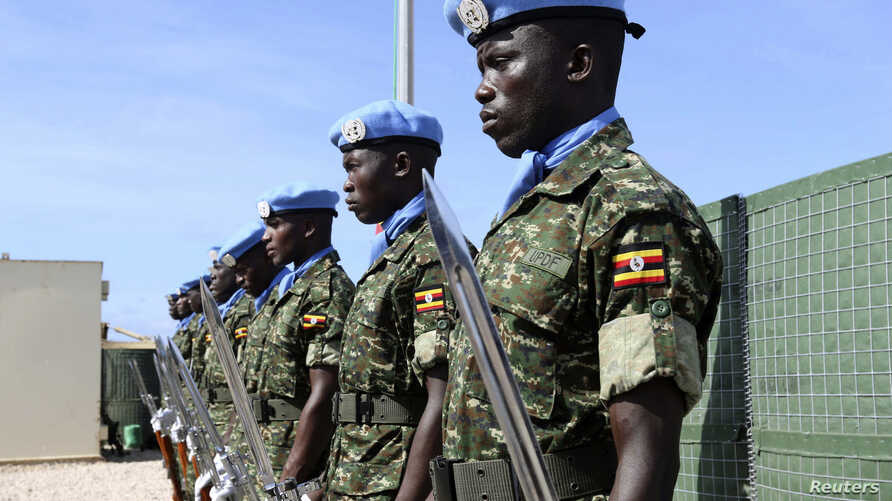 Ugandan peacekeeping troops stand during a ceremony at Mogadishu airport in Somalia May 18, 2014. U.N.-backed peacekeepers pushed the Islamist fighters out of Mogadishu in 2011, but the al Qaida-linked group has continued to launch guerrilla-style at