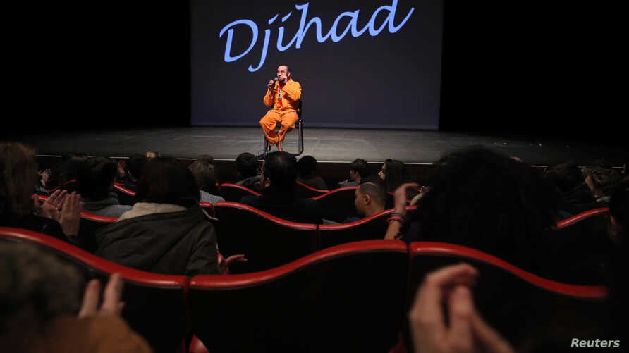 """Belgian playwright and actor Ismael Saidi sits on stage after a presentation of his play """"Jihad"""" to speak to students in the audience at a theatre in Valenciennes, France, Jan. 4, 2017."""