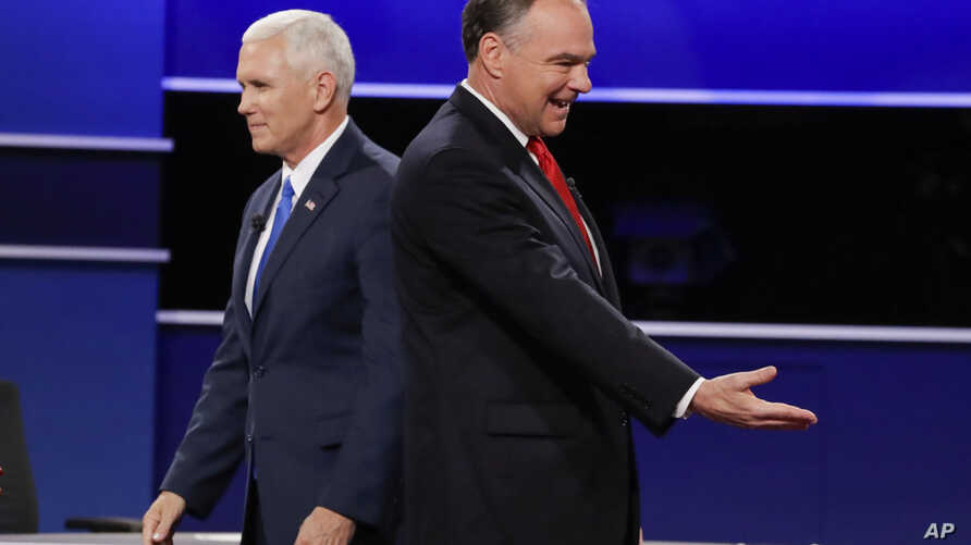 Republican vice-presidential nominee Gov. Mike Pence and Democratic vice-presidential nominee Sen. Tim Kaine, right, walk past each other after the vice-presidential debate at Longwood University in Farmville, Va., Tuesday, Oct. 4, 2016.