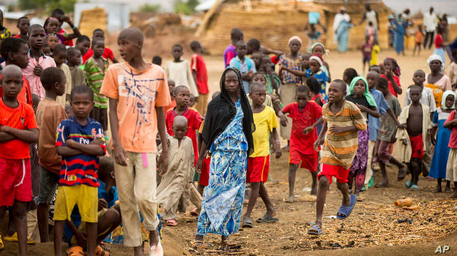 FILE - Refugees are seen gathered at Minawao Refugee Camp in northern Cameroon, April 18, 2016. The U.N. refugee agency has called on Cameroon to stop forcibly repatriating Nigerians refugees on its territory.