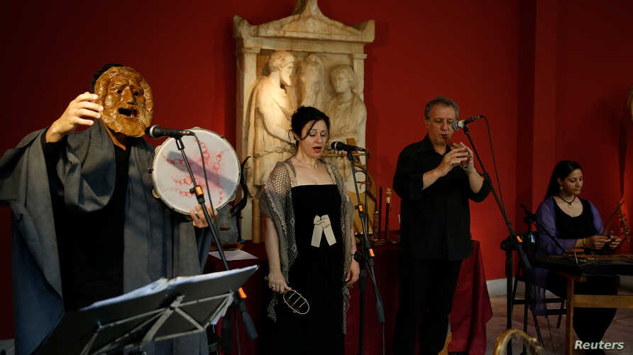 Musicians perform during a concert with reconstructed ancient instruments at the National Archaeological Museum in Athens, Greece, June 21, 2018.