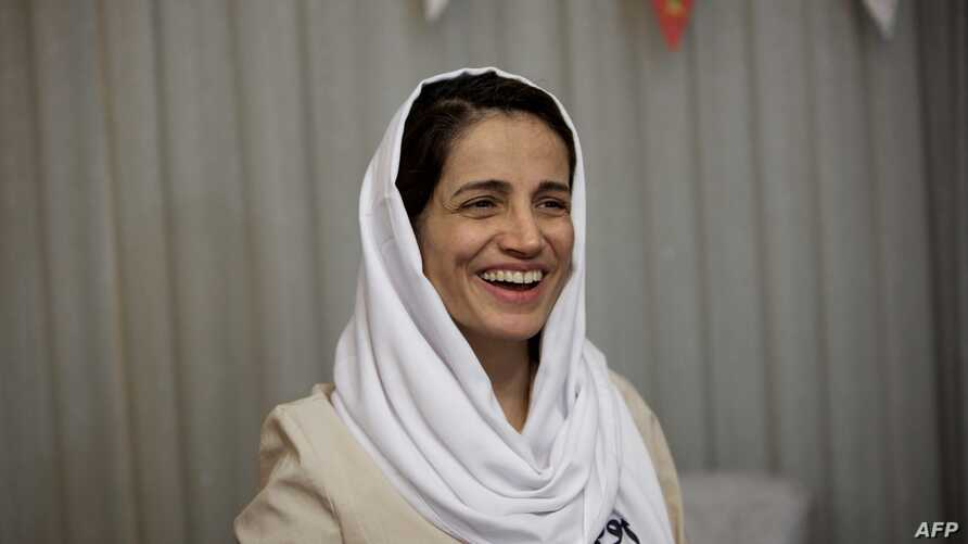 Iranian lawyer Nasrin Sotoudeh smiles at her home in Tehran, Sept. 18, 2013, after being freed following three years in prison.