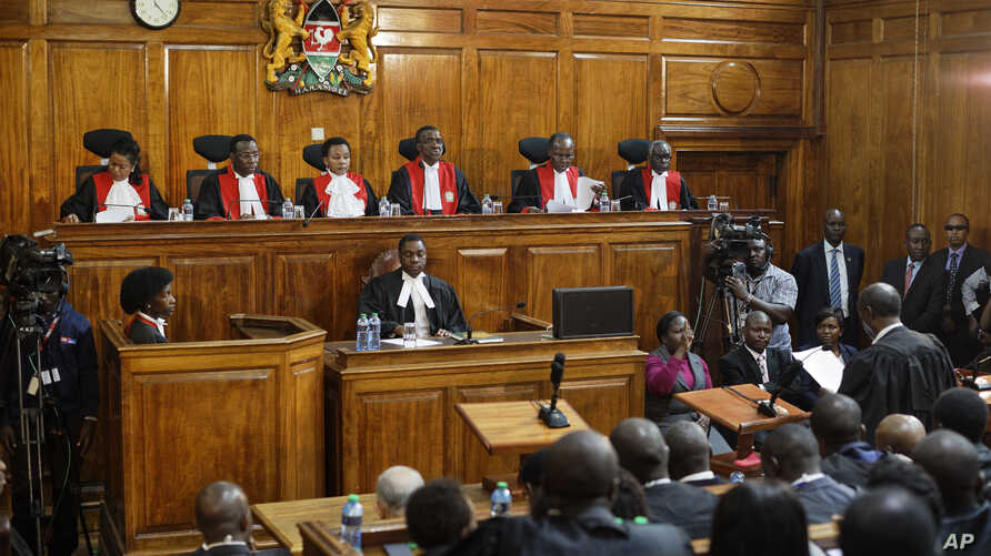 Kenyan Supreme Court judges from left, Njoki Ndung'u, Jackton Ojwang, Deputy Chief Justice Philomela Mwilu, Chief Justice David Maraga, Smokin Wanjala and Isaac Lenaola deliver the verdict on a petition challenging the presidential election result, a