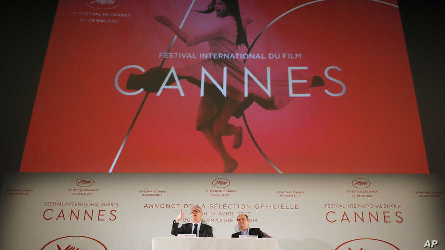 General Delegate of the Cannes Film Festival Thierry Fremaux, left and Cannes Film Festival President Pierre Lescure attend a press conference for the presentation of the 70th Cannes film festival, in Paris, April 13, 2017.