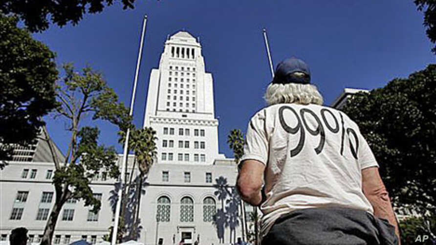 Occupy LA protester Mike Oren, of Bowling Green, Ohio, stands outside Los Angeles City Hall in Los Angeles, October 27, 2011.