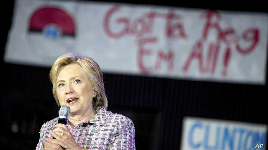 A Pokemon poster is visible behind Democratic presidential candidate Hillary Clinton as she speaks to volunteers at a Democratic party organizing event at the Neighborhood Theater in Charlotte, N.C., July 25, 2016.