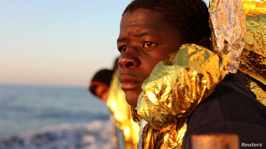 A migrant, covered with a thermal blanket, gazes at the sea aboard the former fishing trawler Golfo Azzurro of the Spanish NGO Proactiva Open Arms following a rescue operation near the coasts of Libya in the central Mediterranean Sea, Feb. 3, 2017.