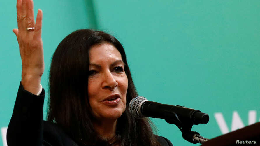 FILE - Paris Mayor Anne Hidalgo speaks during the C40 Cities Women4Climate event in New York City, March 15, 2017.