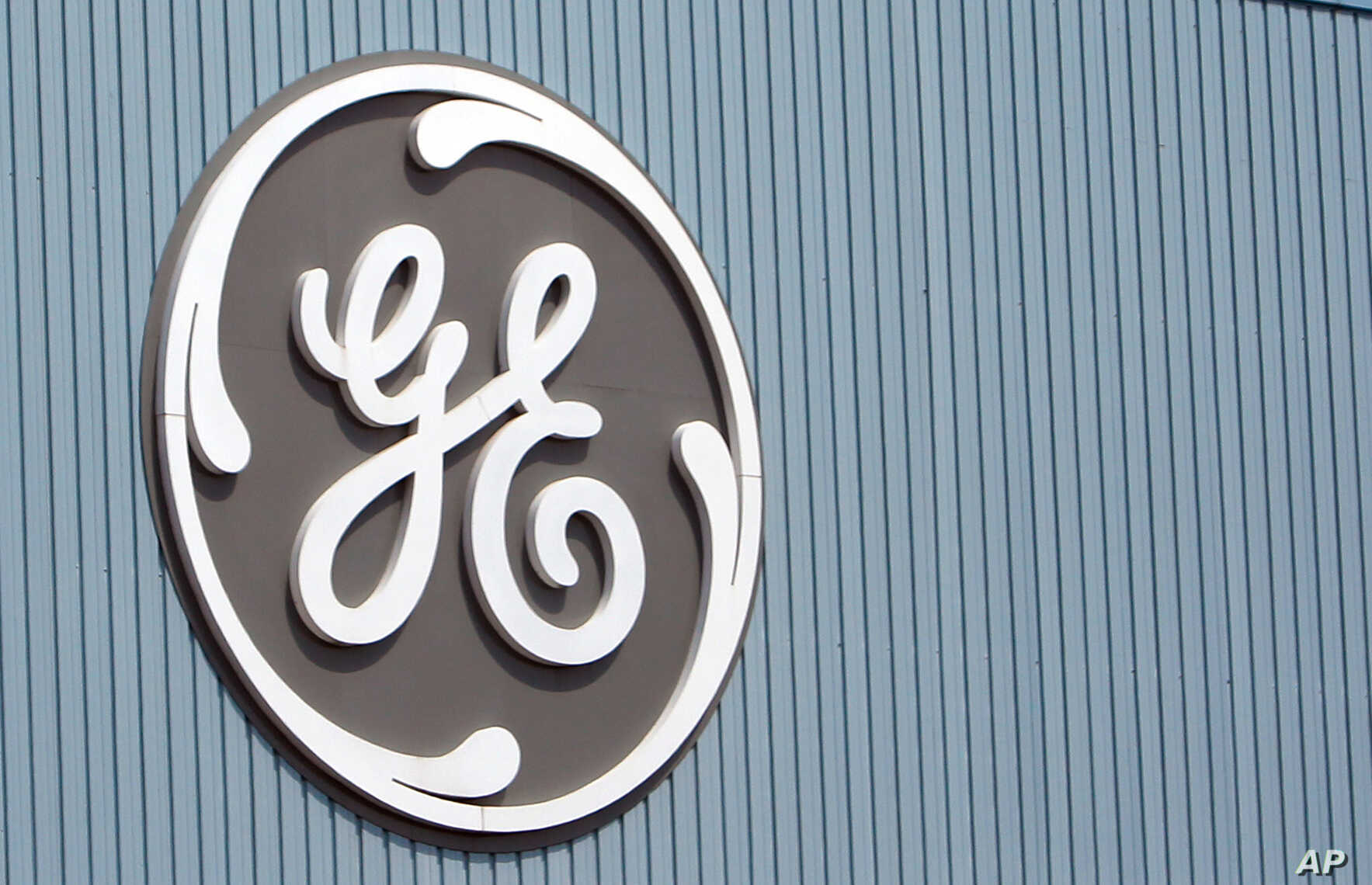 FILE - The General Electric logo is seen at a plant in Belfort, eastern France, in June 2014.