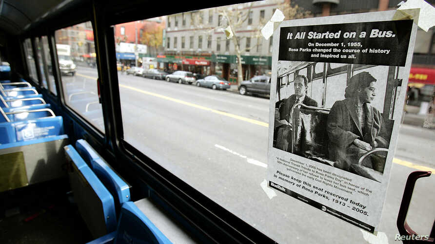 """FILE - A poster entitled """"It All Started On A Bus,"""" is pasted above the front seat of a New York City bus to honor Rosa Parks in New York, Dec. 1, 2005."""