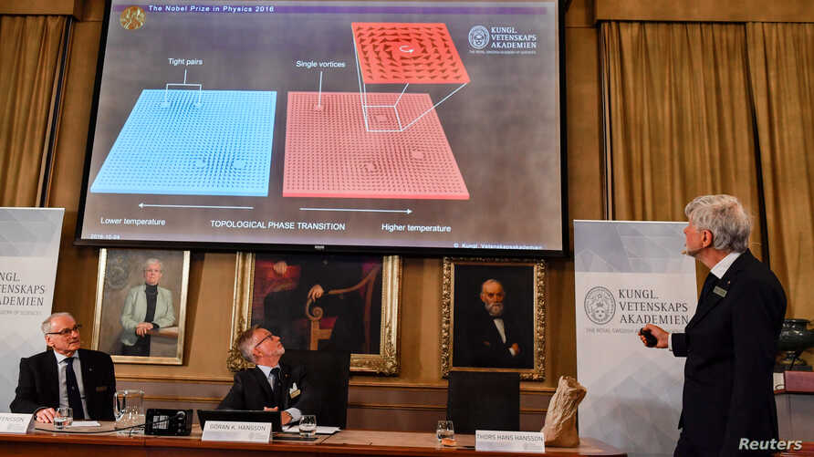 Thomas Hans Hansson (R), one of the members of the Royal Academy of Sciences, speaks during a news conference announcing the winners of the 2016 Nobel Prize for Physics in Stockholm, Sweden, Oct. 4, 2016.